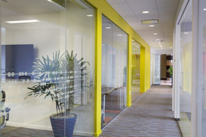 Hallway with vibrant yellow walls at the Duke Street Carr Workplaces location