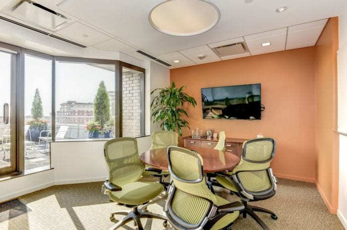 Small conference room with a window overlooking a pretty balcony area