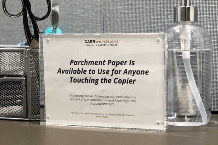 Sign noting parchment paper readily available to Carr Workplaces members