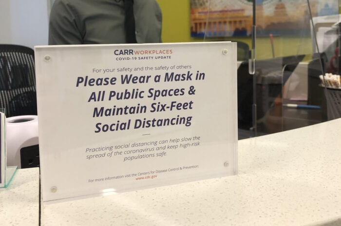 """Please Wear a Mask"" sign at Carr Workplaces Fort Lauderdale"
