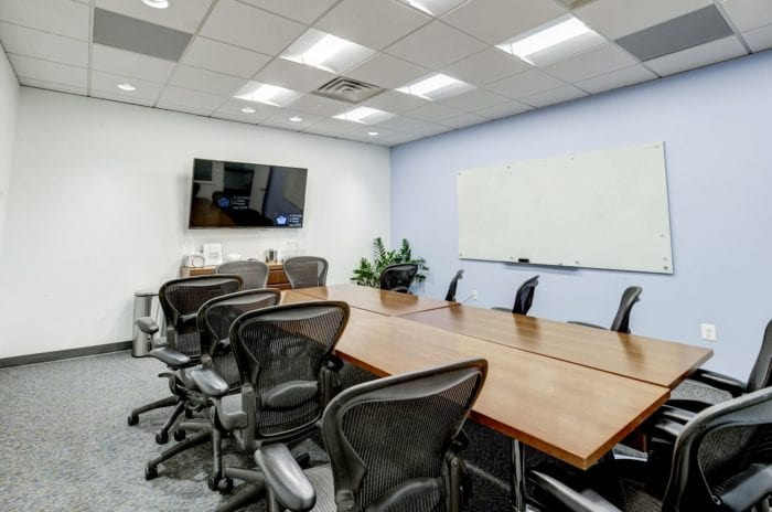 Carr Workplaces meeting room at Old Town, with a high tech TV and a large white board.